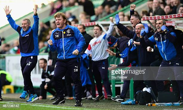 Rangers manager Stuart McCall celebrates the opening goal during the Scottish Championship match between Hibernian and Rangers at Easter Road on...