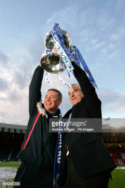 Rangers' manager Walter Smith and assistant Ally McCoist celebrate with the CIS Insurance Cup