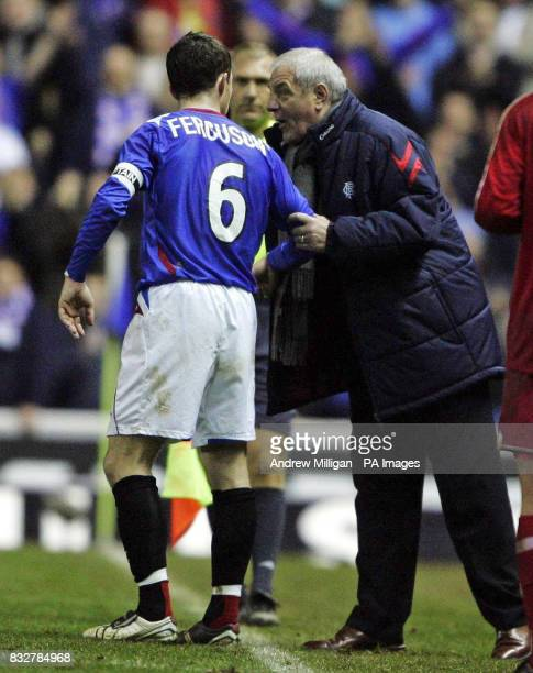 Rangers manager Walter Smith talks with Barry Ferguson after goalkeeper Allan McGregor was sent off during the UEFA Cup Third Round Second Leg match...