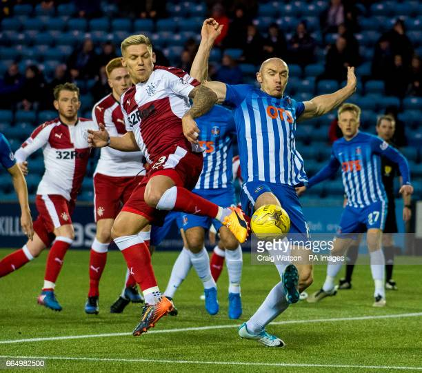 Rangers' Martin Waghorn and Kilmarnock's Connor Sammon compete for the ball during the Ladbrokes Scottish Premiership match at Rugby Park Kilmarnock