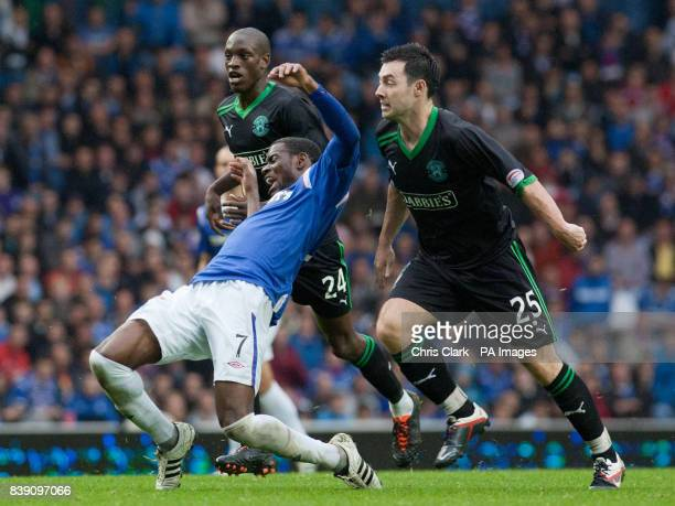 Rangers' Maurice Edu is brought down by Hibernian's Isaiah Osbourne and Richie Towell during the Clydesdale Bank Scottish Premier League match at...