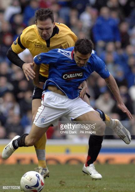 Rangers' Nacho Novo holds off Cedric Uras of Falkirk from the ball during the Bank of Scotland Premier League match at Ibrox Glasgow