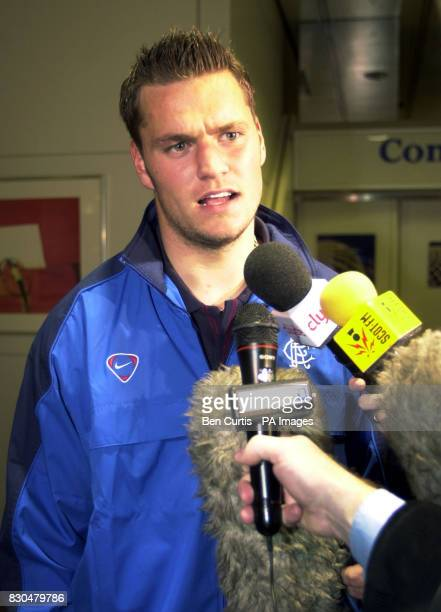 Rangers' newly signed Danish goalkeeper Jesper Christiansen speaks to the media at Glasgow airport before departing on a flight for Austria in...
