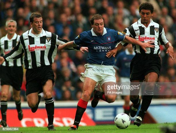 Rangers Paul Gascoigne force through Dunfermline's Miller and Duarte during today's match at Ibrox PA Photos