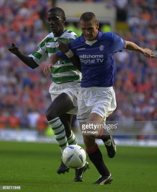 Rangers' Peter Lovenkrands and Celtic's Momo Sylla fight for the ball during their bank of Scotland Scottish Premier League match at Celtic's Celtic...