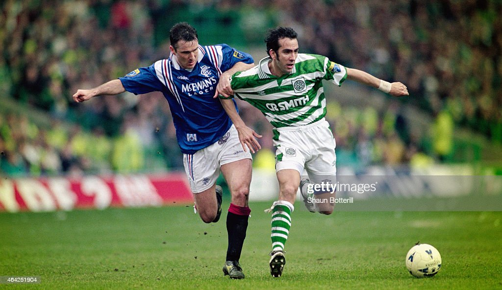 Rangers player Ian Ferguson challenges Paolo Di Canio of Celtic during an Old Firm game at Parkhead on March 16 1997 in Glasgow Scotland