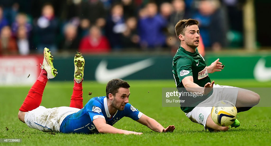 Rangers player Nicky Clark (l) is challenged by Lewis Stevenson of Hibs during the Scottish Championship match between Hibernian and Rangers at Easter Road on March 22, 2015 in Edinburgh, Scotland.