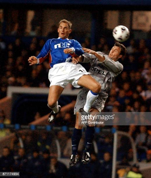 Rangers player Ronald De Boer vies with Paris St Germain's Cristobal Parralo during their UEFA Cup 3rd round first leg match in Glasgow 22 November...