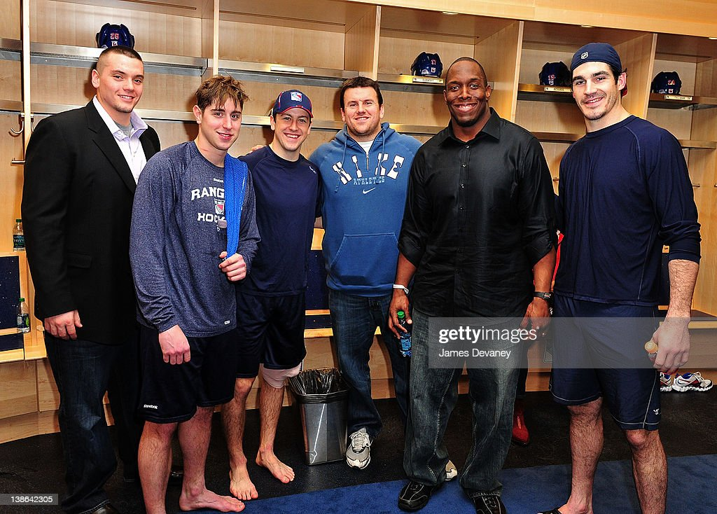 Rangers players <a gi-track='captionPersonalityLinkClicked' href=/galleries/search?phrase=Brandon+Dubinsky&family=editorial&specificpeople=2271907 ng-click='$event.stopPropagation()'>Brandon Dubinsky</a>, <a gi-track='captionPersonalityLinkClicked' href=/galleries/search?phrase=Derek+Stepan&family=editorial&specificpeople=4687181 ng-click='$event.stopPropagation()'>Derek Stepan</a> and Brian Boyle pose with New York Giants players in the Rangers locker room after the Tampa Bay Lightning vs the New York Rangers game at Madison Square Garden on February 9, 2012 in New York City.