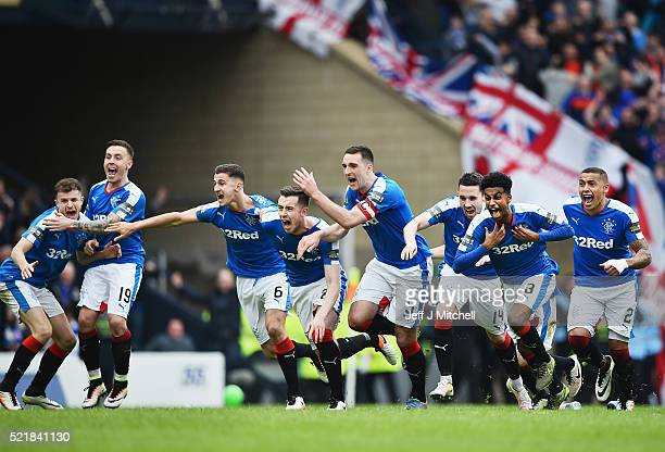 Rangers players celebrate after beating Celtic in a penalty shoot out during the William Hill Scottish Cup semi final between Rangers and Celtic at...