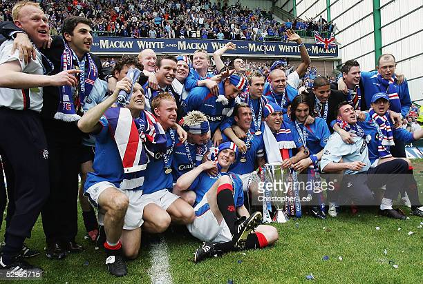 Rangers players celebrate with the Scottish Premier League Trophy during the Bank of Scotland Scottish Premier League match between Hibernian and...