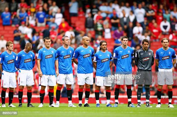 Rangers players line up during a minute's applause in remembrance of Sir Bobby Robson prior to the Emirates Cup match between Glasgow Rangers and...
