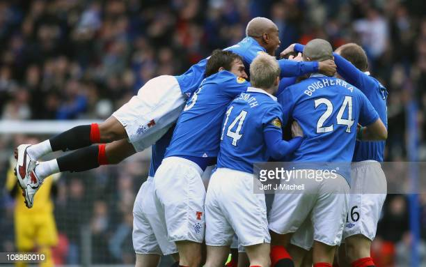 Rangers players surround Jamie Ness after scoring during the Scottish Cup 5th round match between Rangers and Celtic at Ibrox Stadium on February 6...