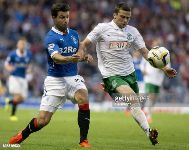 Rangers' Richard Foster and Hibernian's Lewis Stevenson battle for the ball during the Petrofac Training Cup match at Ibrox Glasgow
