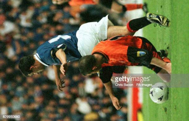 Ranger's Rino Gattuso takes the ball off Andy McLaren of Dundee Utd during Coca Cola Quarter final at Ibrox tonight Photo by Chris Bacon/PA