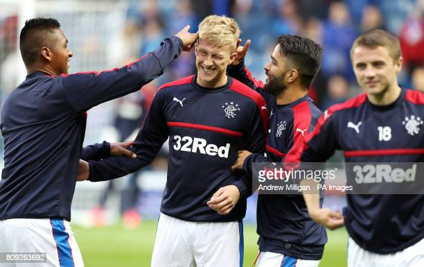 Rangers' Ross McCrorie has his ears flicked by teammates Alfredo Morelos and Daniel Candeias