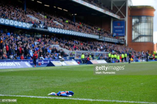 Rangers scarf is tossed onto the pitch after Celtic's 5th goal during the Ladbrokes Scottish Premiership match between Rangers FC and Celtic FC at...