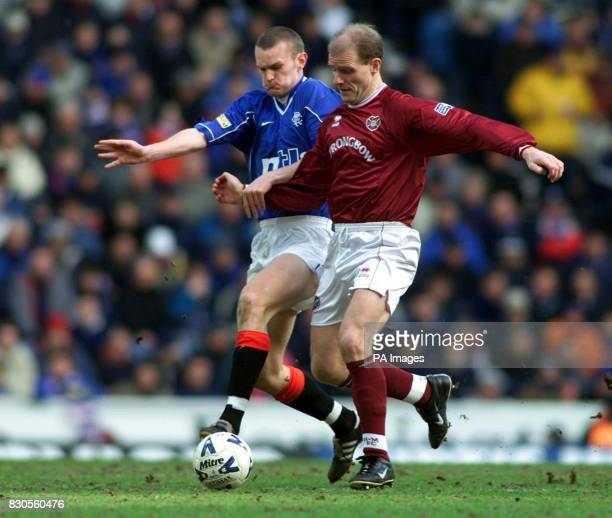Rangers' Scott Wilson goes in for a tackle on Hearts' Gordon Durie during their Bank of Scotland Scottish Premiership match at Ibrox Stadium Glasgow...