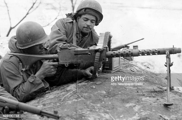 Rangers Sgt Howard Squires Jr and Cpl Marion A Alston man the observation post during the Korean War Korea July 1 1950