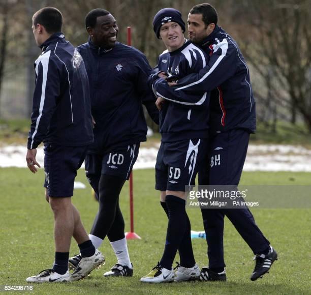 Rangers Steve Davis jokes with Brahim Hemdani during a training session at Murray Park Glasgow