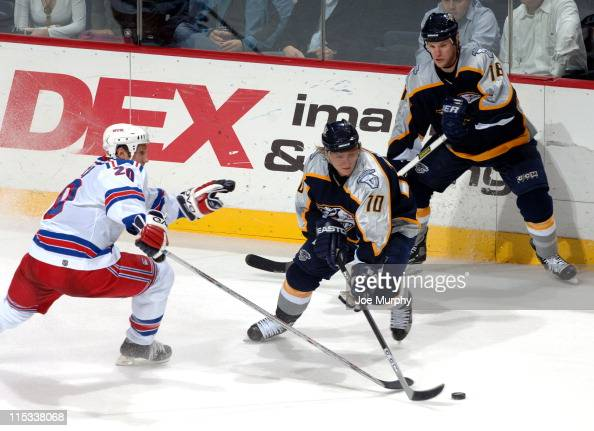 Rangers Steve Rucchin and Predators Martin Erat fight for the puck during the 3rd period of the game between the New York Rangers and the Nashville...