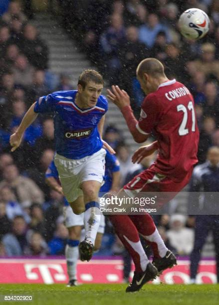 Rangers' Steven Davis crosses the ball past Aberdeen's Andrew Considine during the Clydesdale Bank Scottish Premier League match at Ibrox Stadium...