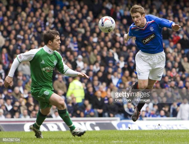 Rangers' Steven Davis heads the ball past Hibernian's Ross Chisholm during the Clydesdale Bank Premier League match at Ibrox Glasgow