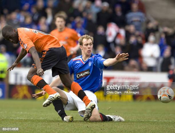 Rangers' Steven Whittaker tackles Dundee United's Morgaro Gomis during the Clydesdale Bank Premier League match at Tannadice Park Dundee
