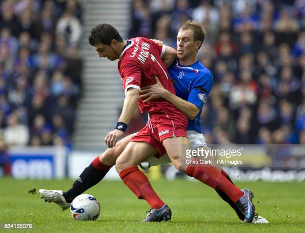 Rangers' Steven Whittaker tackles Falkirk's Pedro Moutinho during the Clydesdale Bank Scottish Premier League match at Ibrox Stadium Glasgow
