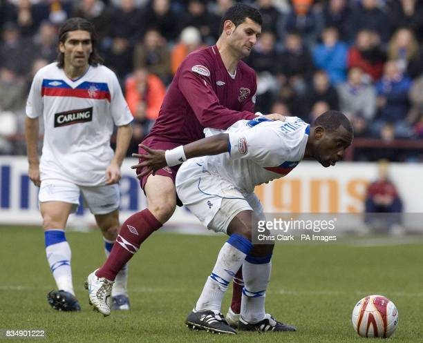 Rangers striker JeanClaude Darcheville shields the ball from Hearts defender Christos Karipidis during the Clydesdale Bank Premier League match at...