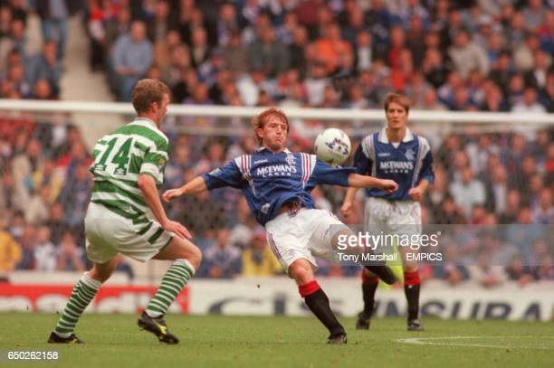 Rangers' Stuart McCall is watched by Celtic's Morten Wieghorst