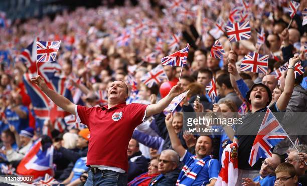 Rangers supporters wave Union Jack flags during the Clydesdale Bank Premier League match between Rangers and Celtic at Ibrox Stadium salutes his...
