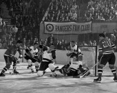 Rangers vs Detroit Rangers Andy Bathgate and Phil Goyette keep the ice close to the melting point in front of the Detroit goal in second period of...