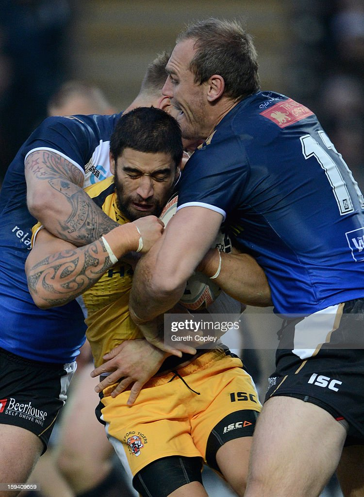 Rangi Chase of Castleford is tackled by Gareth Ellis of Hull FC during a pre-season friendly match between Hull FC and Castleford Tigers at The KC Stadium on January 13, 2013 in Hull, England.