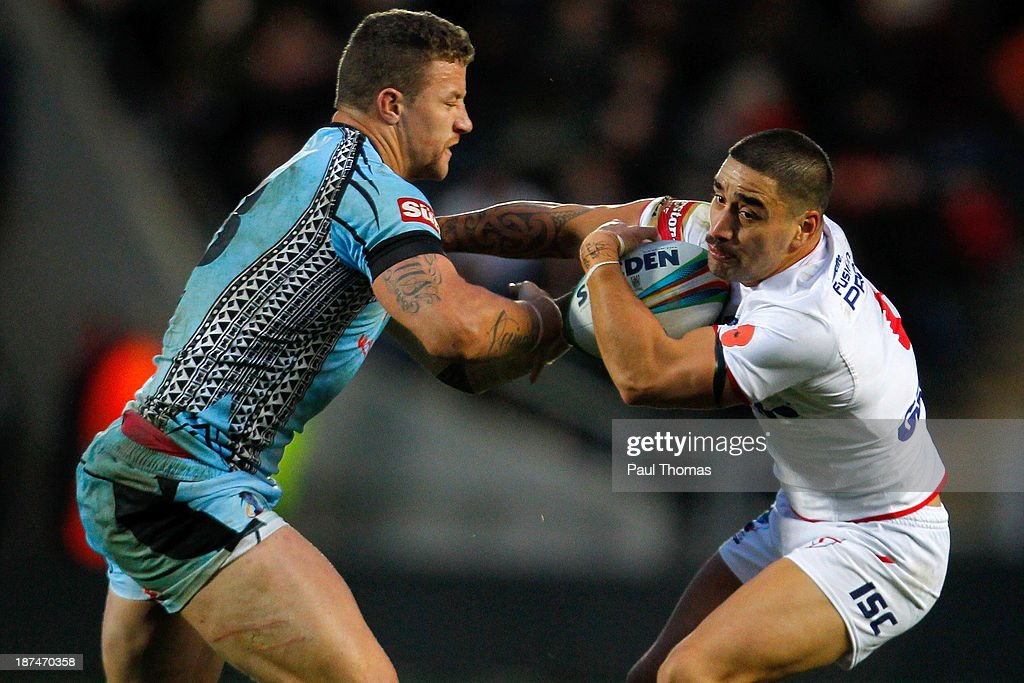Rangi Chase (R) of England in action with Korbin Sims of Fiji during the Rugby League World Cup Group A match at the KC Stadium on November 9, 2013 in Hull, England.
