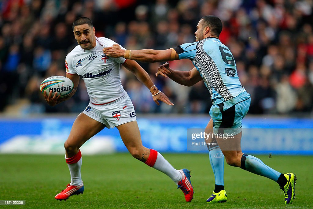 Rangi Chase (L) of England in action with Ryan Millard of Fiji during the Rugby League World Cup Group A match at the KC Stadium on November 9, 2013 in Hull, England.