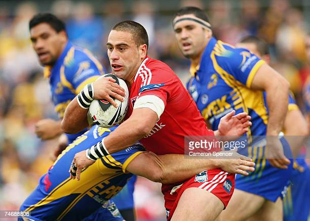 Rangi Chase of the Dragons is tackled during the round 14 NRL match between the Parramatta Eels and the St George Illawarra Dragons at Parramatta...