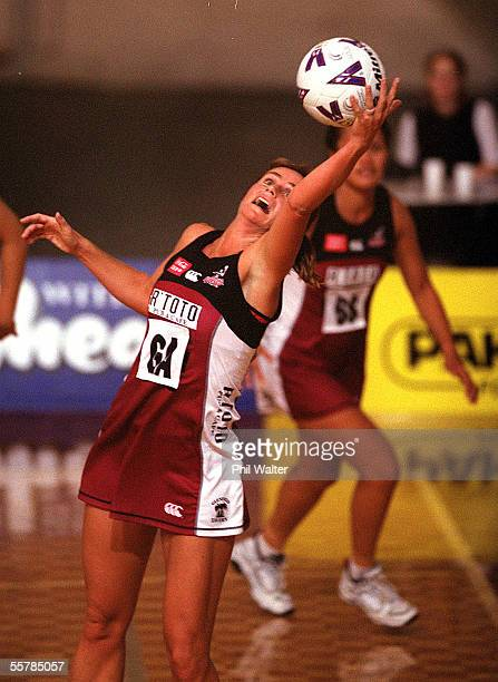 Rangitoto Force Tania Dalton stretches to take the ball against the BOP Magic in their CocaCola Netball Cup match played at the North Shore Event's...