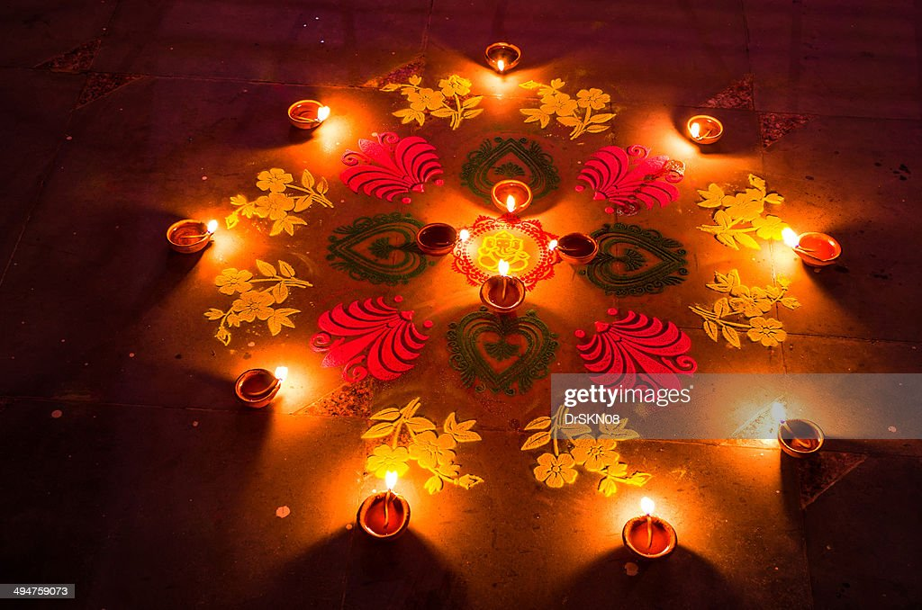 Rangoli and candles in Diwali nights