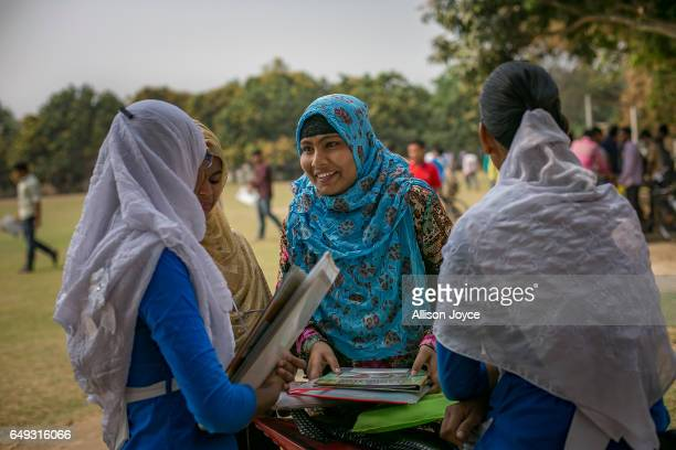 Rani chats with friends before taking an exam on March 6 2017 in Khulna division Bangladesh Rani who is now 16 was under pressure to marry a boy when...