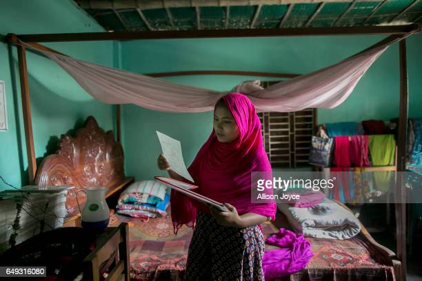 Rani goes through some school papers on March 6 2017 in Khulna division Bangladesh Rani who is now 16 was under pressure to marry a boy when she was...