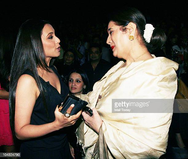 Rani Mukherjee chats up with Sonakshi Sinha at designer Manish Malhotra's show on the fourth day of Lakme Fashion Week in Mumbai on September 20 2010
