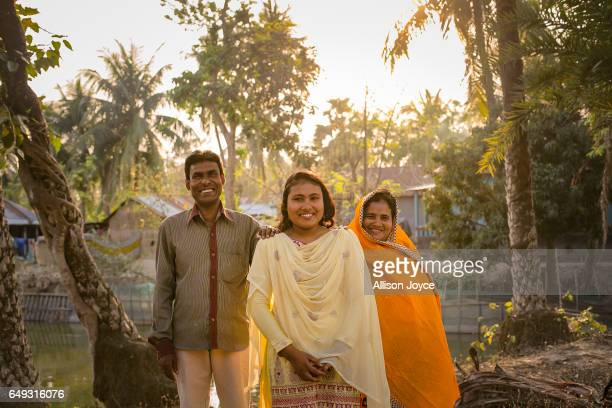 Rani poses for a photo with her father Abdul and mother Pori on March 6 2017 in Khulna division Bangladesh Rani who is now 16 was under pressure to...