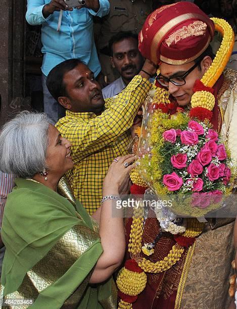 Rani Promoda Devi the widow of the late prince of the Mysore Kingdom Srikantadatta Narasimharaja Wadiyar greets Yaduveer Gopal Raj Urs after his...