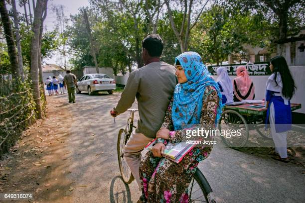 Rani rides home with her father on the back of his bicycle on March 6 2017 in Khulna division Bangladesh Rani who is now 16 was under pressure to...