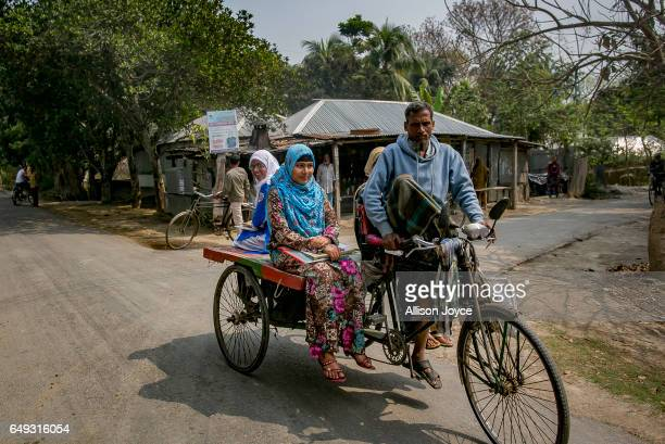 Rani rides on a rickshaw to take a school exam March 6 2017 in Khulna division Bangladesh Rani who is now 16 was under pressure to marry a boy when...