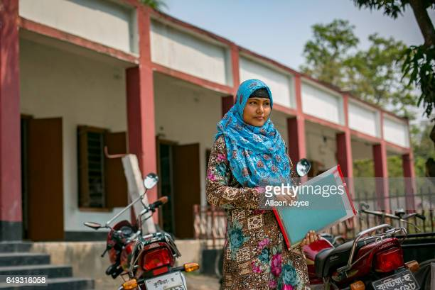 Rani stands outside a school before sitting for an exam March 6 2017 in Khulna division Bangladesh Rani who is now 16 was under pressure to marry a...