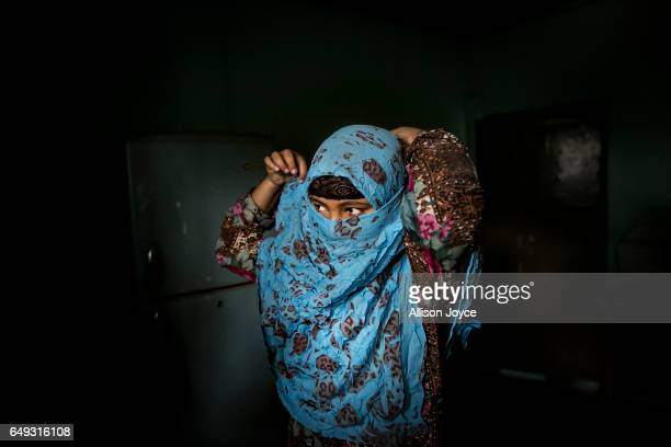 Rani ties her scarf around her face before leaving her home to take a school exam March 6 2017 in Khulna division Bangladesh Rani who is now 16 was...