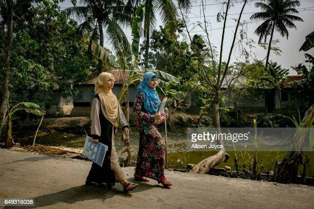 Rani walks with a friend to catch a rickshaw to take a school exam March 6 2017 in Khulna division Bangladesh Rani who is now 16 was under pressure...
