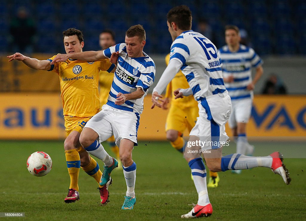 Ranisav Jovanovic (C) of Duisburg and Oliver Petersch of Braunschweig compete for the ball during the Second Bundesliga match between MSV Duisburg and Eintracht Braunschweig at Schauinsland-Reisen-Arena on March 4, 2013 in Duisburg, Germany.